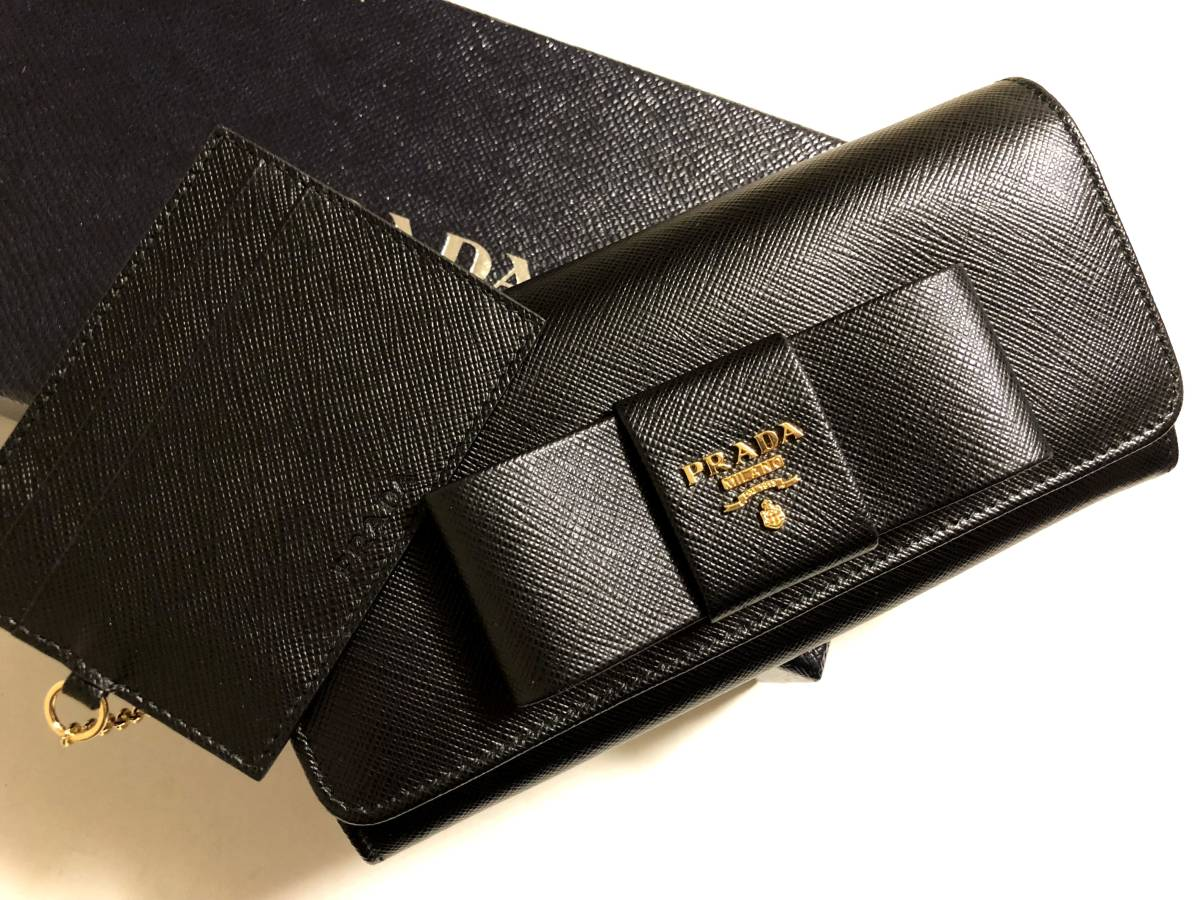 73c4cbb36d6a 新品未使用☆PRADA プラダ☆リボン サフィアーノ レザー 二つ折り長財布 パスケース